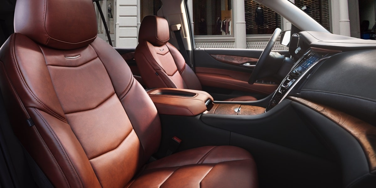 2019 Escalade SUV front seats with leather seating surfaces.