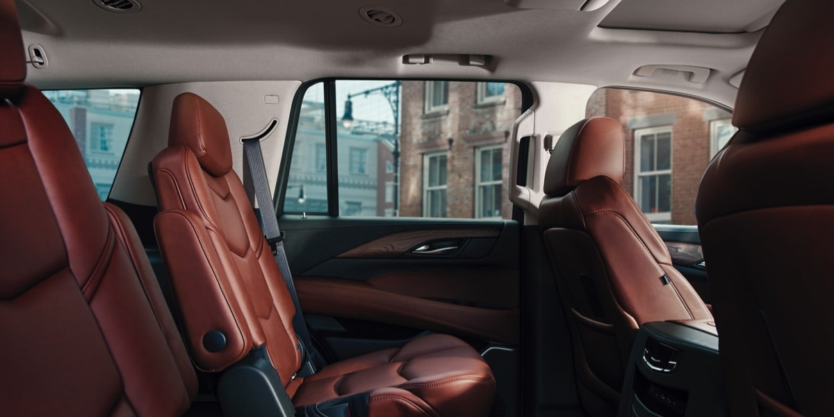 Interior of the 2019 Cadillac Escalade full-size luxury SUV's backseats.
