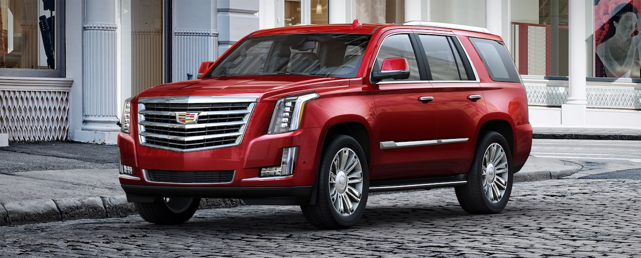 Exterior of the 2019 Cadillac Escalade full-size luxury SUV in Red Passion Tintcoat.