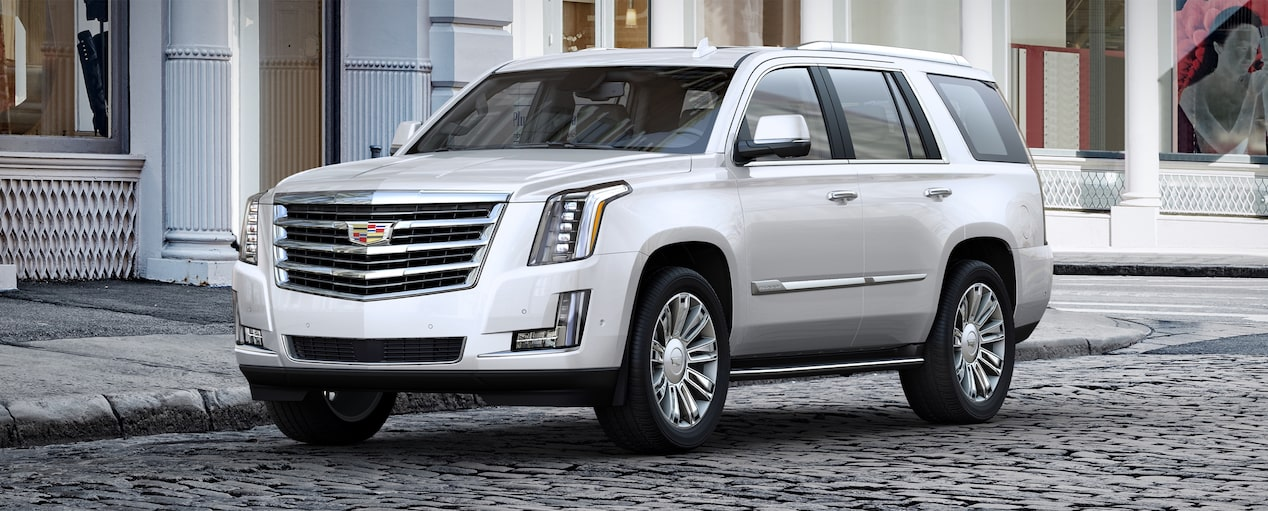 Exterior of the 2019 Cadillac Escalade full-size luxury SUV in Crystal White Tricoat.