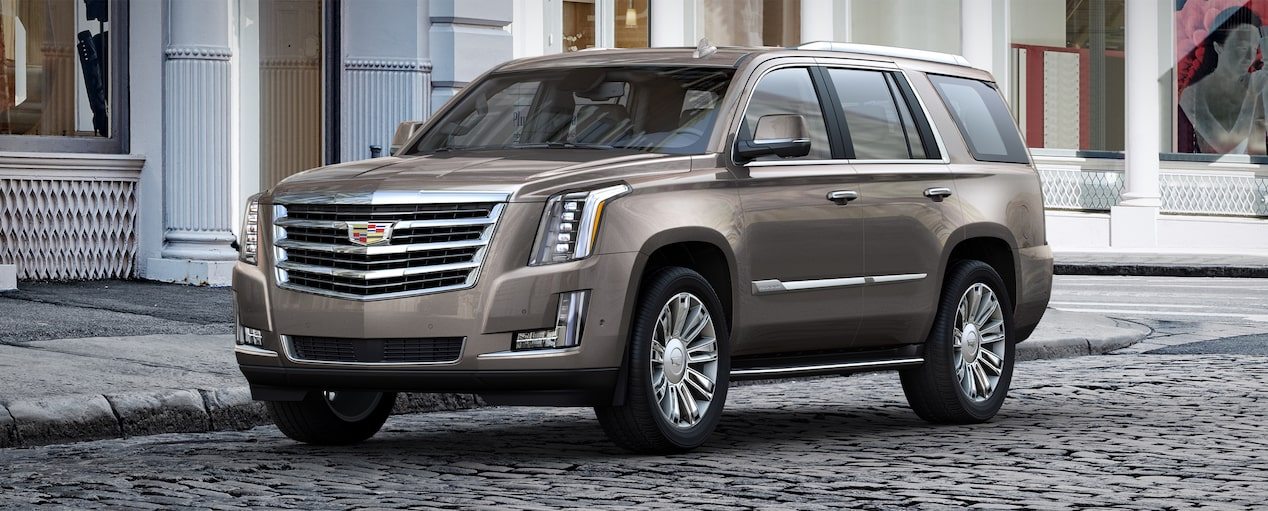 Exterior of the 2019 Cadillac Escalade full-size luxury SUV in Bronze Dune Metallic.