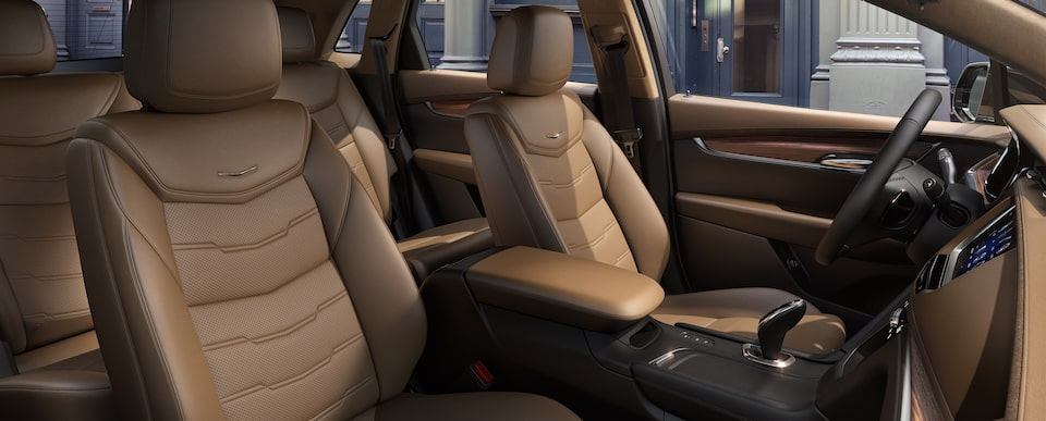 Seats of the Cadillac XT5 luxury crossover in Maple Sugar with Jet Black accents.