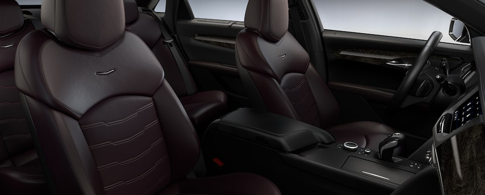 The 2019 CT6 full-size luxury sedan's front seats and centre console in Dark Auburn with Jet Black accents.