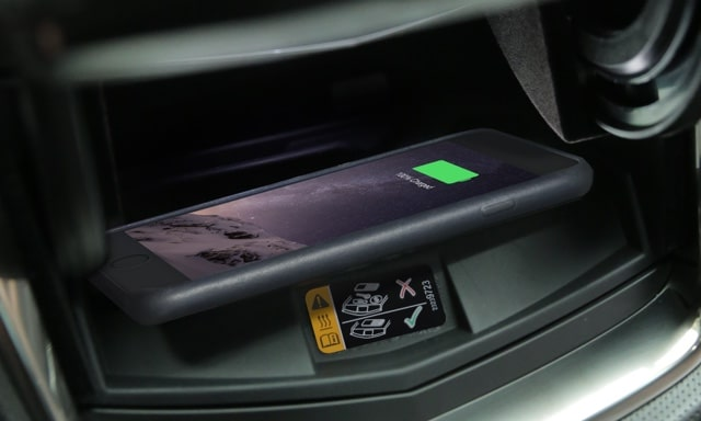 Cadillac CTS mid-size luxury sedan technology: Wireless Phone Charging.