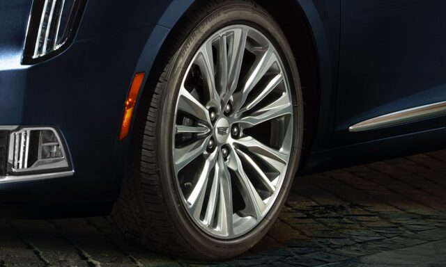 Cadillac XTS full-size luxury sedan exterior: available 19-inch polished wheels.