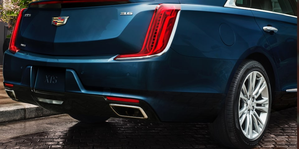 2019 XTS Sedan exterior: vertical taillamps on rear profile.