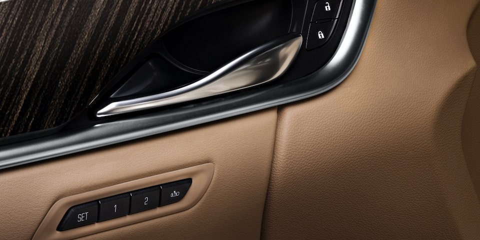 Cadillac XTS interior: natural finish wood trim and available Semi-Aniline leather.