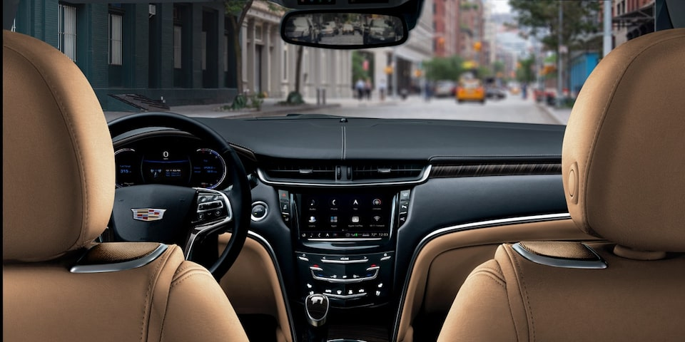 2019 Cadillac XTS interior: steering wheel and centre console.