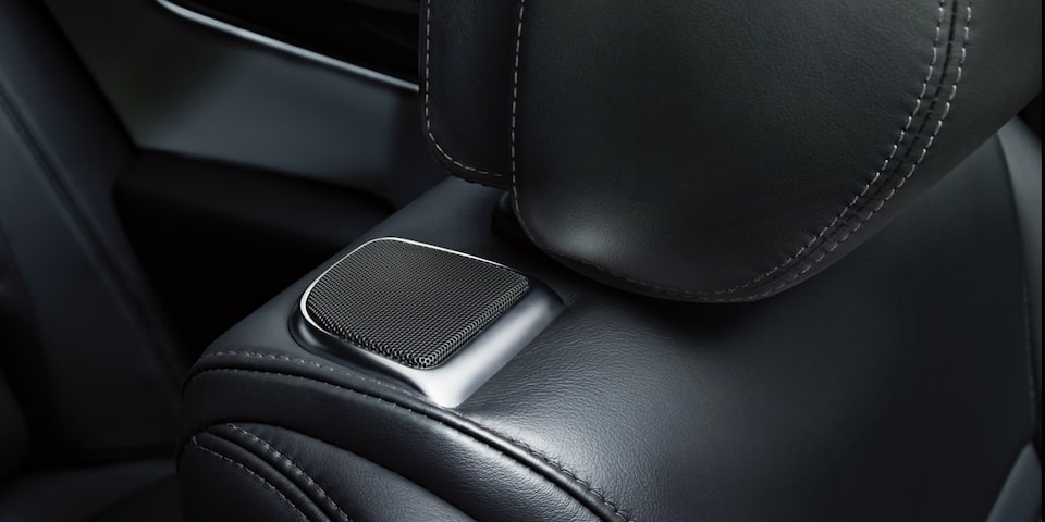 Seating in the Cadillac XTS Sedan with available built-in speakers.