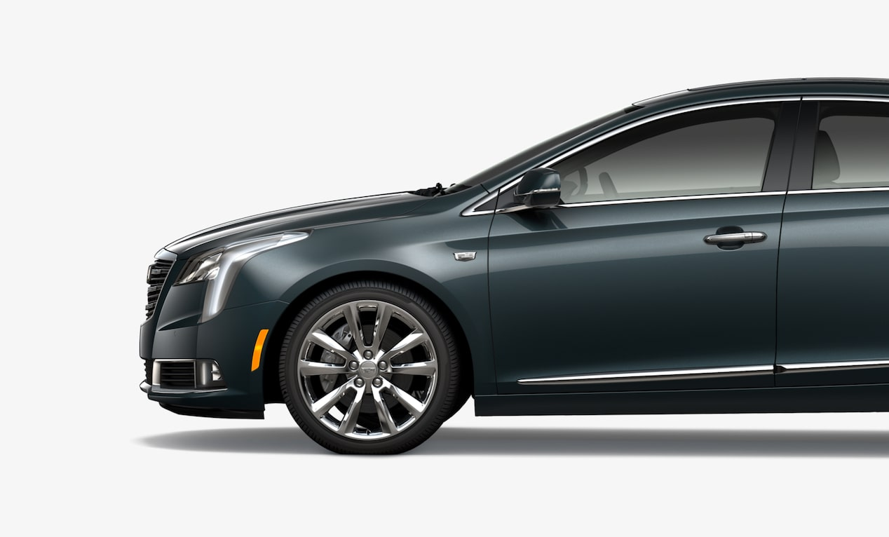Side exterior profile of the Cadillac XTS full-size luxury sedan.