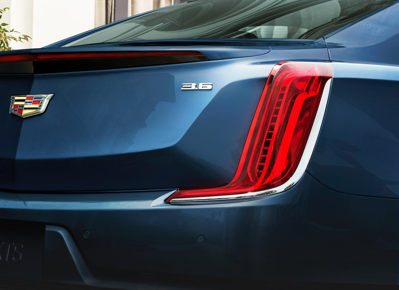 2019 XTS Sedan exterior: vertical taillamps on a rear profile.