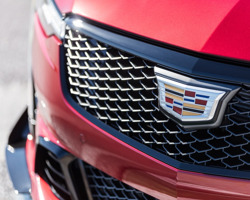 Close-up view of the 2022 CT4-V Blackwing front grille featuring the Cadillac insignia.