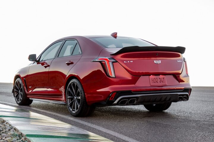 Back side view of the 2022 Cadillac CT4-V Blackwing parked on the road.