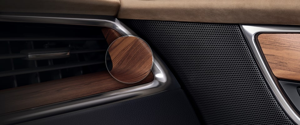 Cadillac interior with natural wood, premium leather and performance materials.