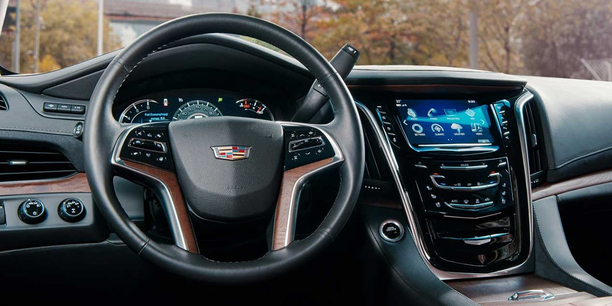 2019 Cadillac Escalade SUV's dashboard and steering wheel.