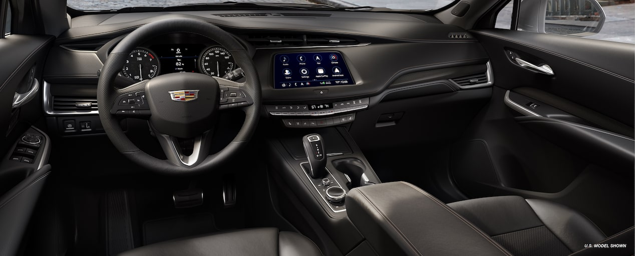 The interior view of 2019 Cadillac XT4 luxury crossover in Jet Black with Cinnamon Accents.