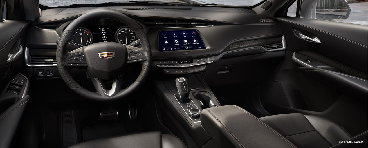 The interior view of 2019 Cadillac XT4 luxury crossover in Jet Black Leatherette with Cinnamon Accents..
