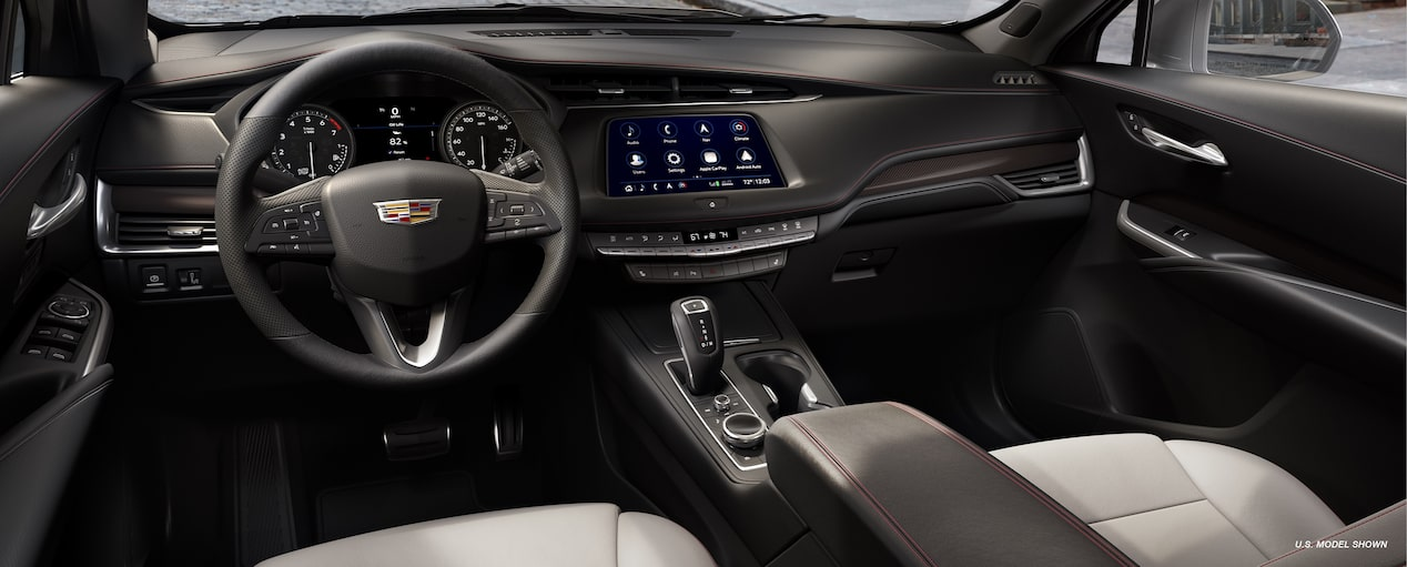 The interior view of 2019 Cadillac XT4 luxury crossover in Light Wheat, Jet Black Leatherette with Red Accents.