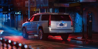 2020 Cadillac Escalade Full-Size SUV Rear Side Exterior at night.