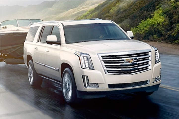 2020 Cadillac Escalade Full-Size SUV Trailering a Boat.