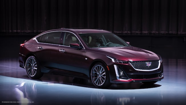 Front-side view of a dark red 2020 Cadillac CT5.