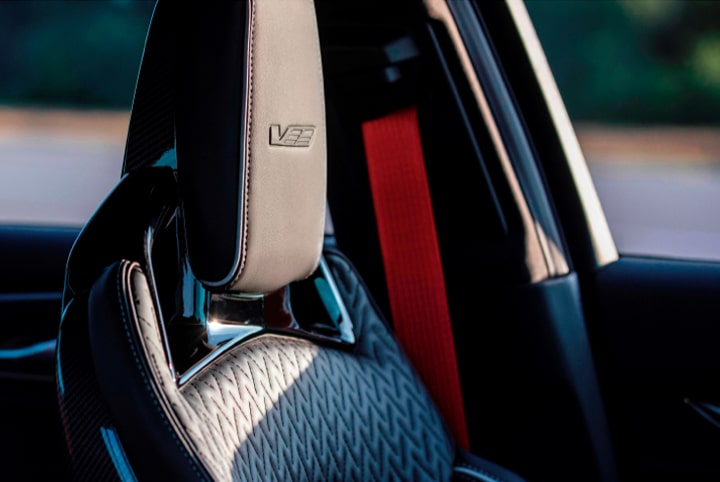 2022 Cadillac CT5-V Blackwing featuring the interior head rest and torch red seat belt.