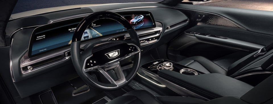 Cadillac LYRIQ interior featuring the dashboard and steering wheel.