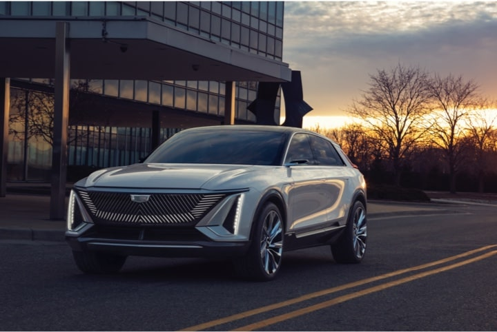 The Cadillac LYRIQ Luxury Electric SUV driving on the road.