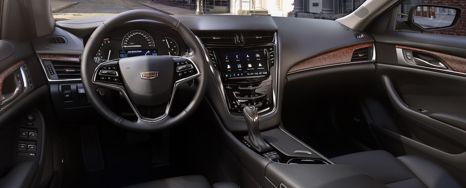 Seats of the Cadillac mid-size luxury sedan in Jet Black with Jet Black accents and Natural Sapele Wood trim.