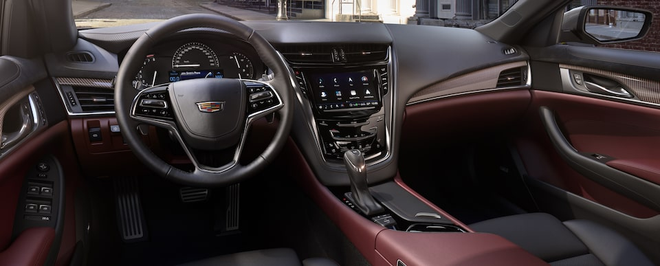 Seats of the Cadillac mid-size luxury sedan in Jet Black with Morello Red accents.